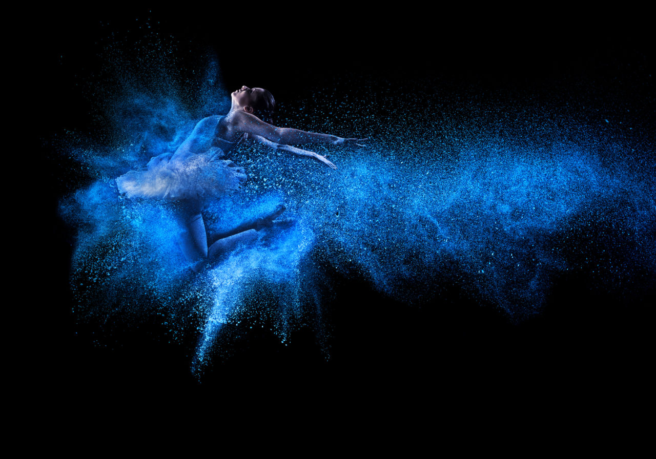 Young-beautiful-dancer-jumping-into-blue-powder-cloud-461209029_2071x1450-1280x896.jpeg